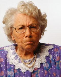 Grumpy senior woman, posing in studio, (Portrait)